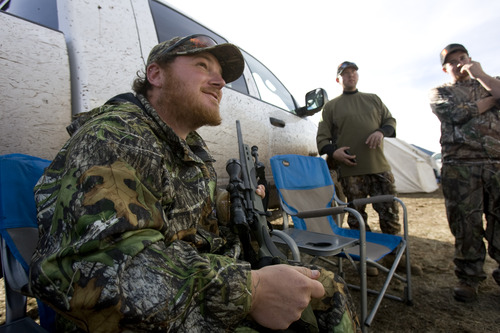 Kim Raff | The Salt Lake Tribune Joey Redhair gets his rifle ready at hunting camp in the Diamond Mountain area outside of Vernal on Oct. 30, 2012.