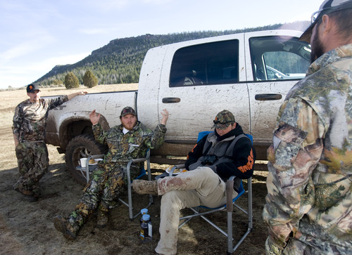 Kim Raff | The Salt Lake Tribune (middle right) Ace and (middle left) Joey Redhair talk about deer and elk they had seen the days before while hunting during dinner at hunting camp in the Diamond Mountain area outside of Vernal.