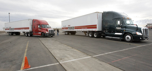 Paul Fraughton  |   Salt Lake Tribune Student truck drivers practice backing up big rigs at the CR England's  driving range.  Friday, November 16, 2012