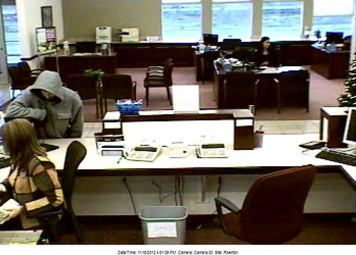 Courtesy of Unified Police Department  Surveillance video shows a man who robbed a Cyprus Credit Union in Riverton on Friday at about 4:50 p.m. He is described as a white man in his 20s, 5-foot-7, 170 pounds, and was wearing a grey hoodie, sun glasses, gloves and a blue bandana on his neck.
