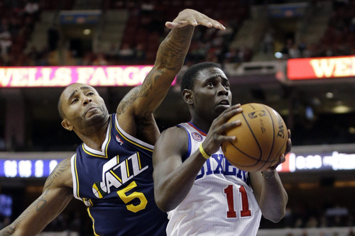 Philadelphia 76ers' Jrue Holiday, right, goes up for a shot as Utah Jazz's Mo Williams defends in the second half of an NBA basketball game, Friday, Nov. 16, 2012, in Philadelphia. Philadelphia won 99-93. (AP Photo/Matt Slocum)