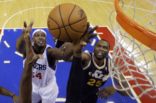 Philadelphia 76ers' Kwame Brown, left, and Utah Jazz's Al Jefferson battle for a rebound in the first half of an NBA basketball game on Friday, Nov. 16, 2012, in Philadelphia. (AP Photo/Matt Slocum)