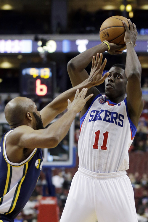Philadelphia 76ers' Jrue Holiday, right, goes up for a shot as Utah Jazz's Jamaal Tinsley defends in the first half of an NBA basketball game on Friday, Nov. 16, 2012, in Philadelphia. (AP Photo/Matt Slocum)