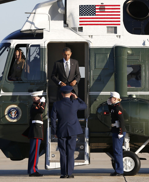 President Barack Obama steps from the Marine One helicopter before boarding Air Force One, Saturday, Nov. 17, 2012, at Andrews Air Force Base, Md., en route to a four-day trip to Thailand, Myanmar and Cambodia, his first trip abroad since June and his fourth trip to Asia. (AP Photo/Carolyn Kaster)