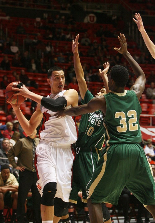 Kim Raff  |  The Salt Lake Tribune (left) University of Utah player Jason Washburn fells the pressure from Sacramento State players (middle) Mikh McKinney and (right) John Dickson during a men's basketball game at the Huntsman Center in Salt Lake City on November 16, 2012.