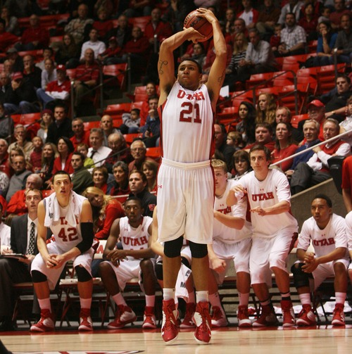 Kim Raff  |  The Salt Lake Tribune University of Utah player Jordan Loveridge attempts a three point shot against Sacramento State during a men's basketball game at the Huntsman Center in Salt Lake City on November 16, 2012. They went on to lose the game 71-74.