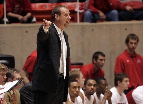 Kim Raff  |  The Salt Lake Tribune University of Utah head coach Larry Krystkowiak yells at his players from the sidelines against Sacramento State during a men's basketball game at the Huntsman Center in Salt Lake City on November 16, 2012. They went on to lose the game 71-74.