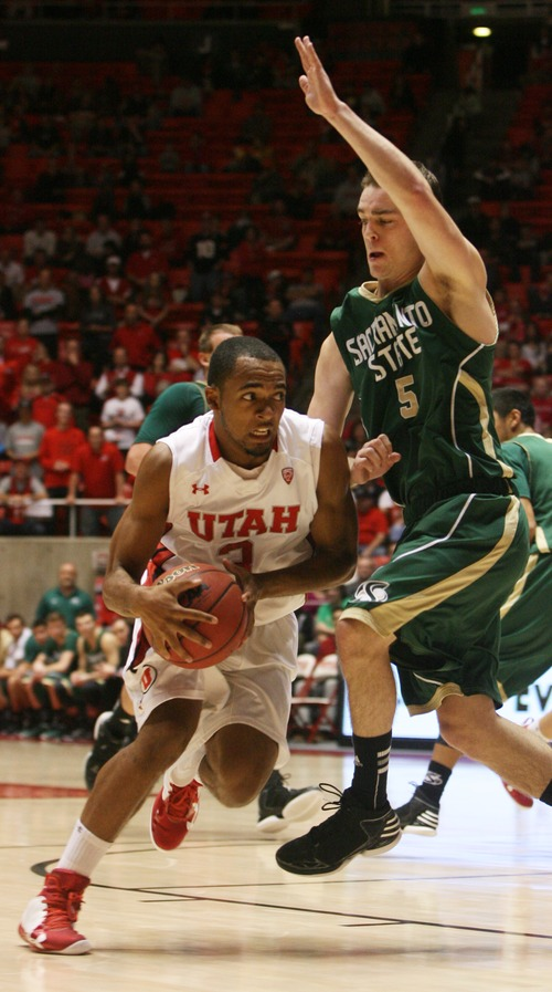 Kim Raff  |  The Salt Lake Tribune University of Utah player (left) Justin Seymour drives the basket past  Sacramento State player Dylan Garrity during a men's basketball game at the Huntsman Center in Salt Lake City on November 16, 2012. They went on to lose the game 71-74.