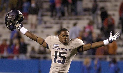 Utah State cornerback Jumanne Robertson (15) celebrates after  their  48-41 win over  Louisiana Tech in their NCAA college football game in Ruston, La., Saturday, Nov. 17, 2012. (AP Photo/Kita Wright)