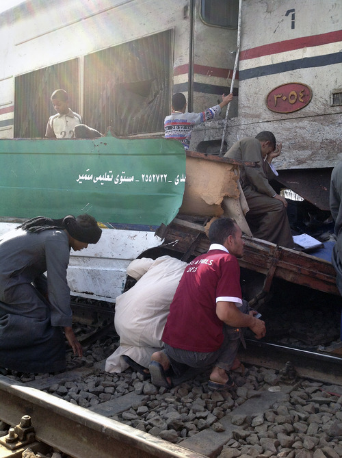 Distraught Egyptians searched for signs of their loved ones in the wreckage of a train crash that killed at least 47 people, most of them children near Assiut  in southern Egypt, Saturday, Nov. 17, 2012. The bus was carrying more than 50 children between 4 and 6 years old when it was hit near al-Mandara village in Manfaloot district in the province of Assiut, a security official said, adding that it appears that the railroad crossing was not closed as the train sped toward it. (AP Photo/Mamdouh Thabet)