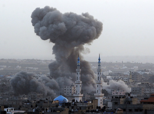 Smoke rises after an Israeli forces strike in Gaza City, Saturday, Nov. 17, 2012. Israel bombarded the Hamas-ruled Gaza Strip with nearly 200 airstrikes early Saturday, the military said, widening a blistering assault on Gaza rocket operations by militants to include the prime minister's headquarters, a police compound and a vast network of smuggling tunnels. (AP Photo/Hatem Moussa)