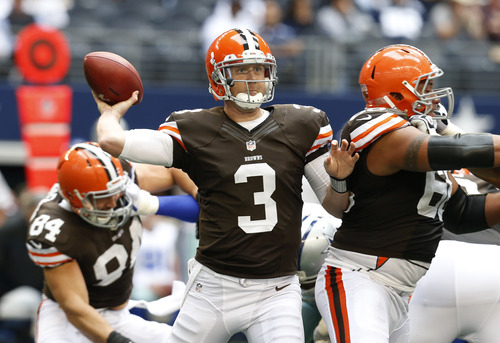 Cleveland Browns' Brandon Weeden (3) passes under protection in the second half of an NFL football game against the Dallas Cowboys Sunday, Nov. 18, 2012, in Arlington, Texas. (AP Photo/Sharon Ellman)
