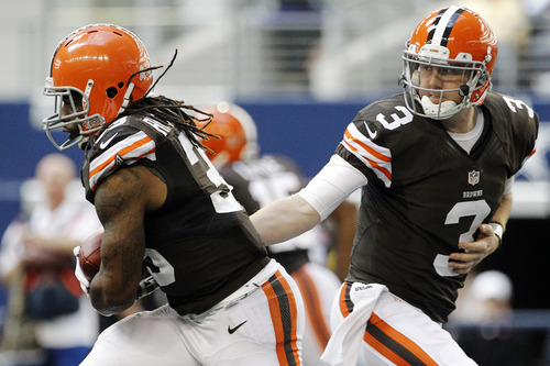 Cleveland Browns' Trent Richardson (33) takes a handoff from quarterback Brandon Weeden (3) in the second half of an NFL football game against the Dallas Cowboys, Sunday, Nov. 18, 2012, in Arlington, Texas. (AP Photo/Brandon Wade)