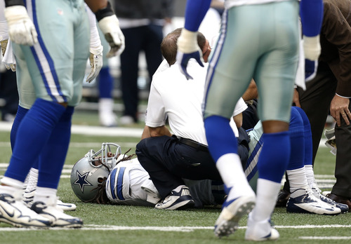 Dallas Cowboys' Danny McCray, on ground, is assisted by staff after suffering an unknown injury in the first half of an NFL football game against the Cleveland Browns Sunday, Nov. 18, 2012, in Arlington, Texas. (AP Photo/Sharon Ellman)