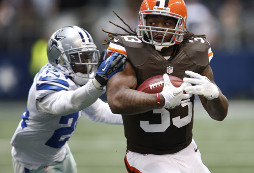 Dallas Cowboys' Morris Claiborne (24) is unable to grab Cleveland Browns' Trent Richardson (33) on a run from scrimmage in the first half of an NFL football game Sunday, Nov. 18, 2012 in Arlington, Texas. (AP Photo/Sharon Ellman)