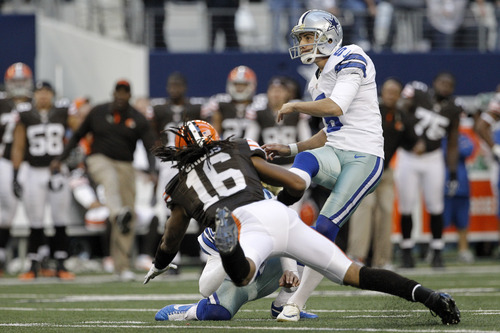 Dallas Cowboys kicker Dan Bailey (5) follows through on a field goal under pressure from Cleveland Browns wide receiver Josh Cribbs (16) late in the second half of an NFL football game Sunday, Nov. 18, 2012 in Arlington, Texas. The field goal sent the game into overtime. (AP Photo/Brandon Wade)
