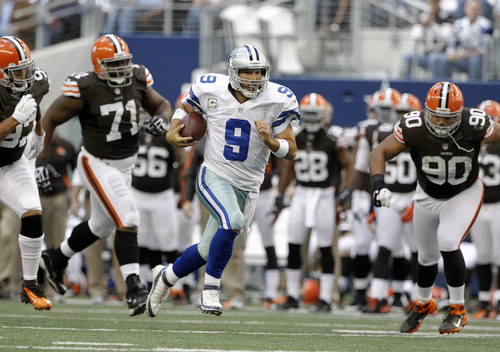 Dallas Cowboys quarterback Tony Romo (9) scrambles under pressure from =tc97, from left, Ahtyba Rubin (71) and Billy Winn in the second half of an NFL football game Sunday, Nov. 18, 2012 in Arlington, Texas. (AP Photo/Brandon Wade)