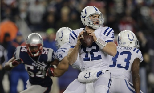 Indianapolis Colts quarterback Andrew Luck (12) looks to pass during the second half of an NFL football game against the New England Patriots at Gillette Stadium in Foxborough, Mass., Sunday, Nov. 18, 2012. (AP Photo/Charles Krupa)