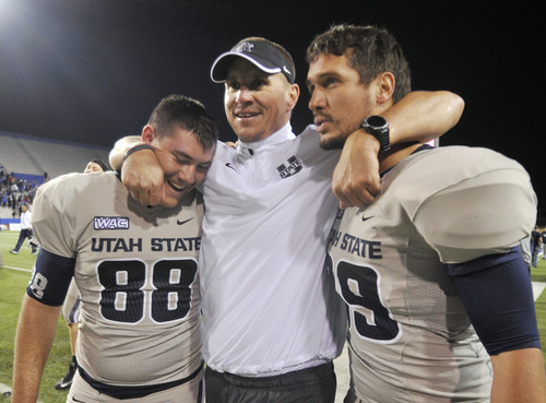 Utah State head coach Gary Andersen , punter Tyler Bennett (88) and teammate celebrate after winning 48-41 against 19th ranked La Tech in their NCAA college football game in Ruston, La., Saturday, Nov. 17, 2012. (AP Photo/Kita Wright)