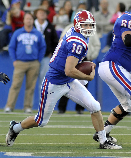 La. Tech quarterback Colby Cameron (10) looking for running room in the first half of play against Utah State during their NCAA college football game in Ruston, La., Saturday, Nov. 17, 2012. (AP Photo/Kita Wright)