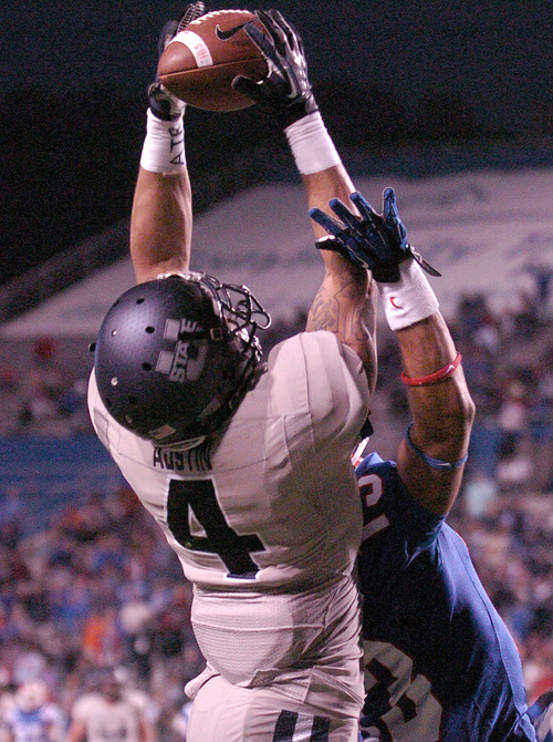 Utah State wide receiver Matt Austin (4) makes a big catch during their NCAA college football game against Louisiana Tech in Ruston, La., Saturday, Nov. 17, 2012. (AP Photo/Kita Wright)