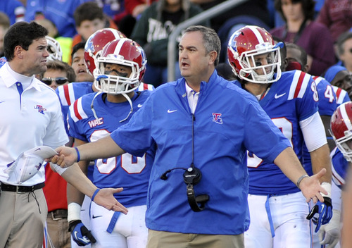 Louisiana  Tech head coach Sonny Dykes was happy with a refree's call during their 48-41 lost to Utah State in thier NCAA college football game in Ruston, La., Saturday, Nov. 17, 2012. (AP Photo/Kita Wright)