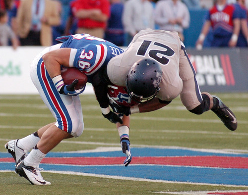 Utah State safety Brian Suite (21) tries to bring down Louisiana Tech running back Hunter Lee (36) during their NCAA college football game in Ruston, La., Saturday, Nov. 17, 2012. (AP Photo/Kita Wright)