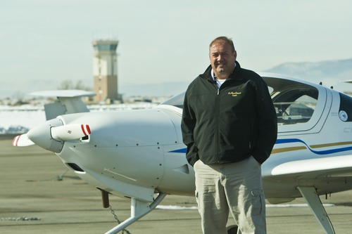 Chris Detrick  |  The Salt Lake Tribune Dr. Peter Dittmer poses for a portrait with a DA-20 airplane at the Utah Valley University pilot training building at the Provo Airport Wednesday November 14, 2012.