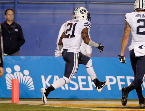 Brigham Young running back Jamaal Williams (21) runs into the end zone for a touchdown in the first quarter of an NCAA college football game against San Jose State in San Jose, Calif., Saturday, Nov. 17, 2012. (AP Photo/John Storey)
