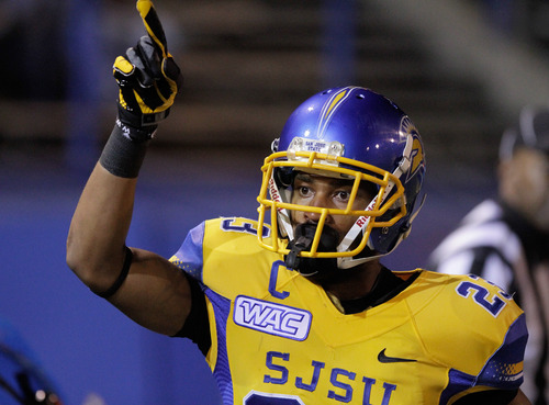 San Jose State wide receiver Noel Grigsby (23) points to the crowd after scoring a touchdown in the first quarter of an NCAA college football game against Brigham Young in San Jose, Calif., Saturday, Nov. 17, 2012. (AP Photo/John Storey)