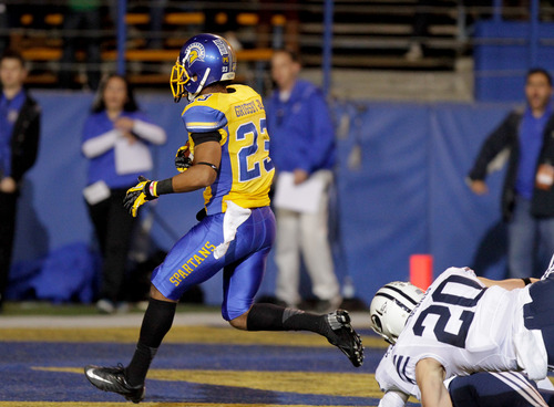 San Jose State wide receiver Noel Grigsby (23) runs in for a touchdown against Brigham Young in the first quarter of an NCAA college football game in San Jose, Calif., Saturday, Nov. 17, 2012. (AP Photo/John Storey)