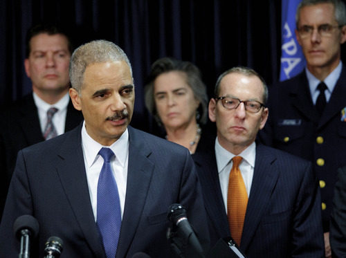 U.S. Attorney General speaks about the 2010 Gulf Oil Spill settlement and criminal penalties at 400 Poydras Tower in the Central Business District of in New Orleans, La. Thursday, Nov. 15, 2012.  Holder said the settlement and indictments aren't the end of federal authorities' efforts and that the criminal investigation is continuing. Holder says much of the money BP has agreed to pay will be used to restore the environment in the Gulf.  (AP Photo/Matthew Hinton)