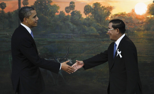U.S. President Barack Obama, left, is greeted by Cambodia's Prime Minister Hun Sen before the ASEAN-U.S. leaders meeting in Phnom Penh, Cambodia, Monday, Nov. 19, 2012.  (AP Photo/Vincent Thian)