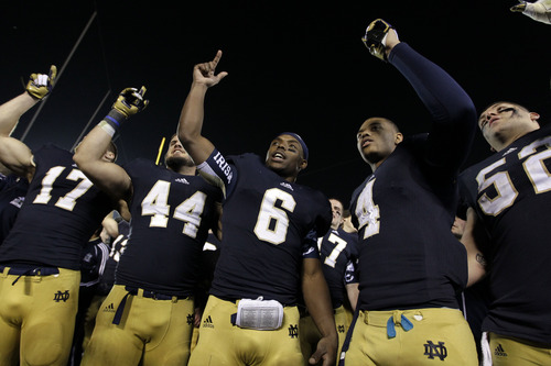 Notre Dame running back Theo Riddick (6) sign the alma mater following an NCAA college football game against Wake Forest in South Bend, Ind., Saturday, Nov. 17, 2012. Notre Dame defeated Wake Forest 38-0. (AP Photo/Michael Conroy)
