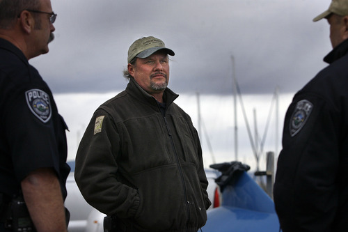 Scott Sommerdorf  |  The Salt Lake Tribune               Great Salt Lake State Marina harbor master Dave Shearer, center, speaks with officers before taking police investigators out to the scene where two hunters died Saturday night on the Great Salt Lake, Sunday, November 18, 2012.