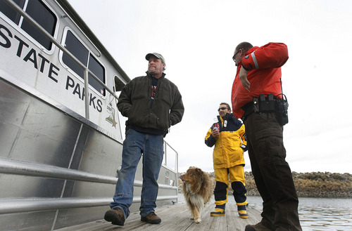 Scott Sommerdorf  |  The Salt Lake Tribune               Great Salt Lake State Marina harbor master Dave Shearer, left, waits prior to taking police investigators out to the scene where two hunters died Saturday night on the Great Salt Lake, Sunday, November 18, 2012.