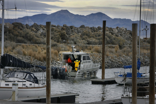 Scott Sommerdorf  |  The Salt Lake Tribune               A Utah State Parks boat piloted by Great Salt Lake State Marina harbor master Dave Shearer takes police investigators out to the scene where two hunters died Saturday night on the Great Salt Lake, Sunday, November 18, 2012.