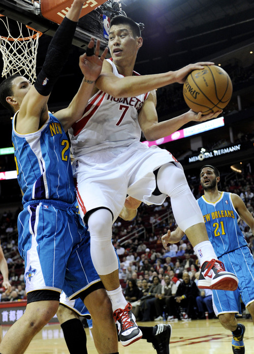 Houston Rockets' Jeremy Lin (7) looks to pass around New Orleans Hornets' Austin Rivers (25) in the second half of an NBA basketball game, Wednesday, Nov. 14, 2012, in Houston. The Rockets won 100-96. (AP Photo/Pat Sullivan)