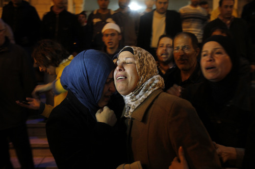 Relatives of  Rushdi Tamimi who died of his injuries sustained two days ago during clashes with Israeli security forces in Nabi Saleh. West Bank, cry in a Ramallah hospital, Monday, Nov. 19, 2012. (AP Photo/Nasser Shiyoukhi)