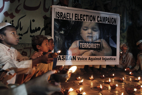 Pakistani students light candles to condemn the Israeli offensive in Gaza in Karachi, Pakistan, Monday, Nov. 19, 2012. (AP Photo/Shakil Adil))