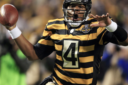 Pittsburgh Steelers quarterback Byron Leftwich (4) celebrates a touchdown in the first quarter of an NFL football game against the Baltimore Ravens, Sunday, Nov. 18, 2012, in Pittsburgh. (AP Photo/Gene J. Puskar)