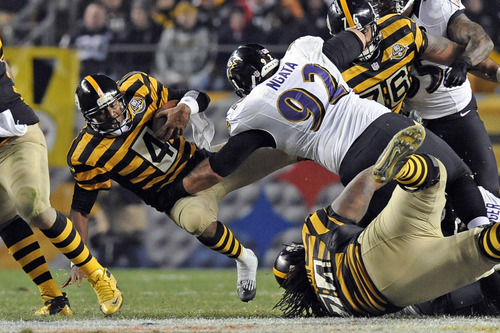 Pittsburgh Steelers quarterback Byron Leftwich (4) is sacked by Baltimore  Ravens defensive end Haloti 0a7698dc2