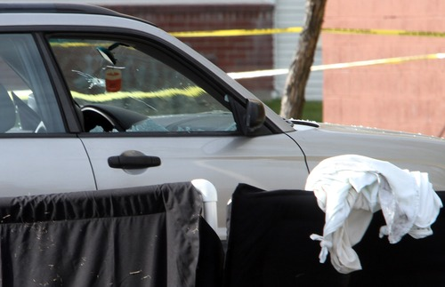 Rick Egan  | The Salt Lake Tribune   A car with a bullet hole in the windshield, and a broken passenger side window, was parked next to the victim of a fatal shooting at the Lexington Park apartments in West Valley City, after a fatal shooting at the complex, Friday, November 2, 2012.