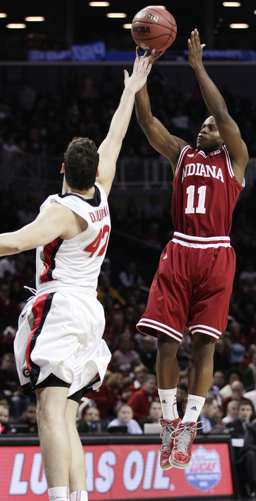 Indiana's Kevin Ferrell (11) shoots over Georgia's Nemanja Djurisic in the first half of their NCAA college basketball game in the Legends Classic, Monday, Nov. 19, 2012, in New York. (AP Photo/Frank Franklin II)