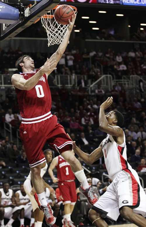Indiana's Will Sheehey (0) shoots over Georgia's Kentavious Caldwell-Pope (1) in the first half of their NCAA college basketball game in the Legends Classic, Monday, Nov. 19, 2012, in New York. (AP Photo/Frank Franklin II)