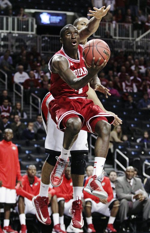 Indiana's Victor Oladipo (4) drives past Georgia's Marcus Thornton in the first half of their NCAA college basketball game in the Legends Classic, Monday, Nov. 19, 2012, in New York. (AP Photo/Frank Franklin II)