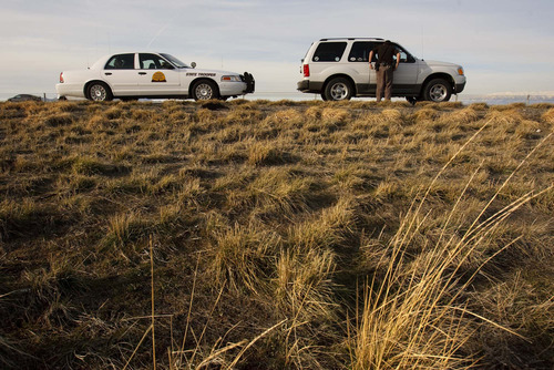Trent Nelson  |  The Salt Lake Tribune  A trooper with the Utah Highway Patrol's criminal interdiction team questions a driver while patrolling I-80 looking for drug traffickers on March 11, 2009.