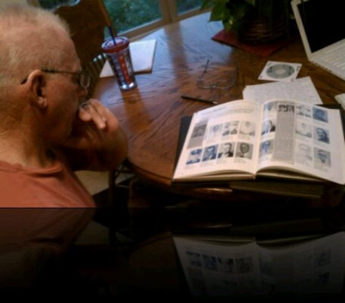 Cimaron Neugebauer | The Salt Lake Tribune Retired trooper Martin Luther Turner III looks through a Utah Highway Patrol yearbook at his home in southern Utah.