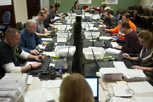 Chris Detrick  |  The Salt Lake Tribune Election staff verify provisional ballots at the Salt Lake County Clerk's Office on Friday. There are around 18,000 provisional ballots and some 25,000 absentee ballots being counted for the final canvass on Tuesday.