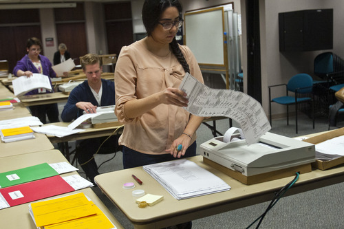 Chris Detrick  |  The Salt Lake Tribune Gracie Velasquez scans provisional ballots at the Salt Lake County Clerks Office on Friday. There are thousands of provisional and absentee ballots still being scrutinized and added to the total before the Election result is final.